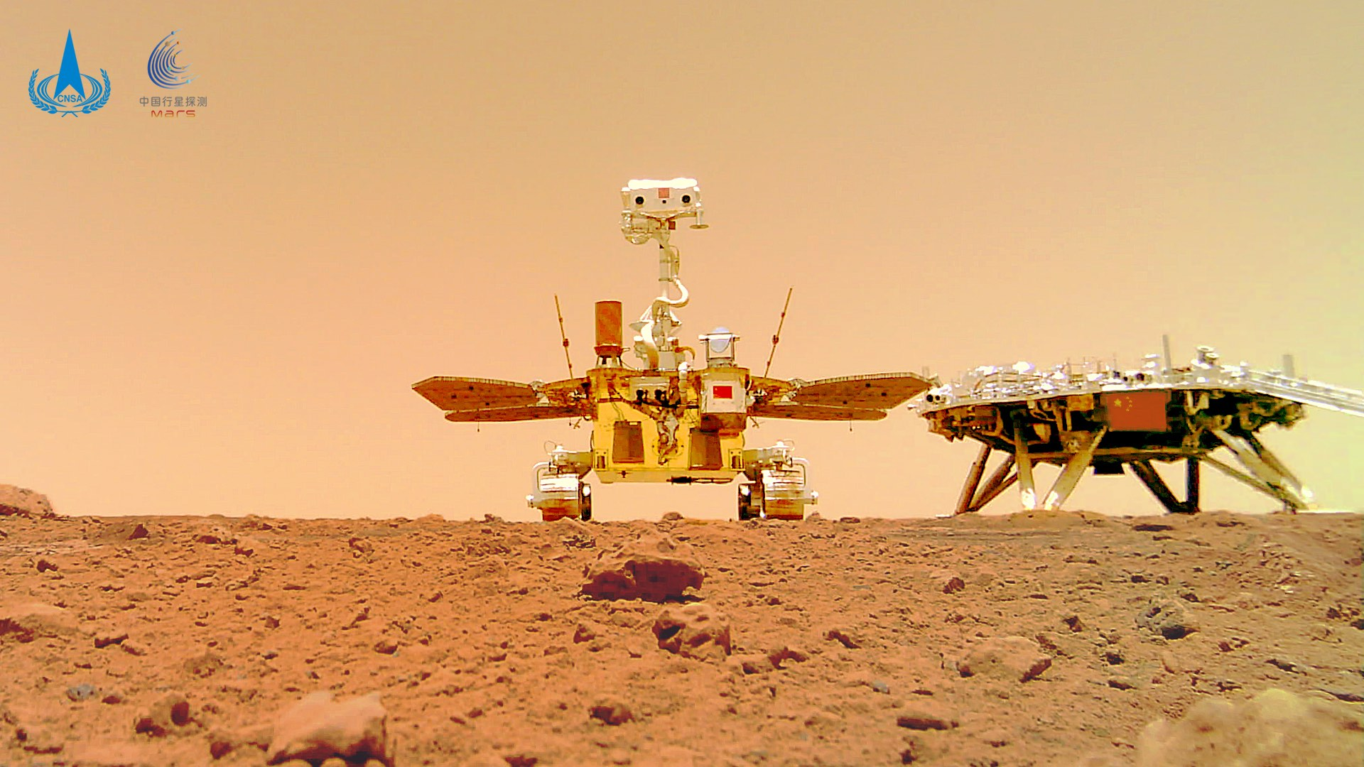 Zhurong with its lander taken by a camera previously placed on the ground. Credit: CNSA