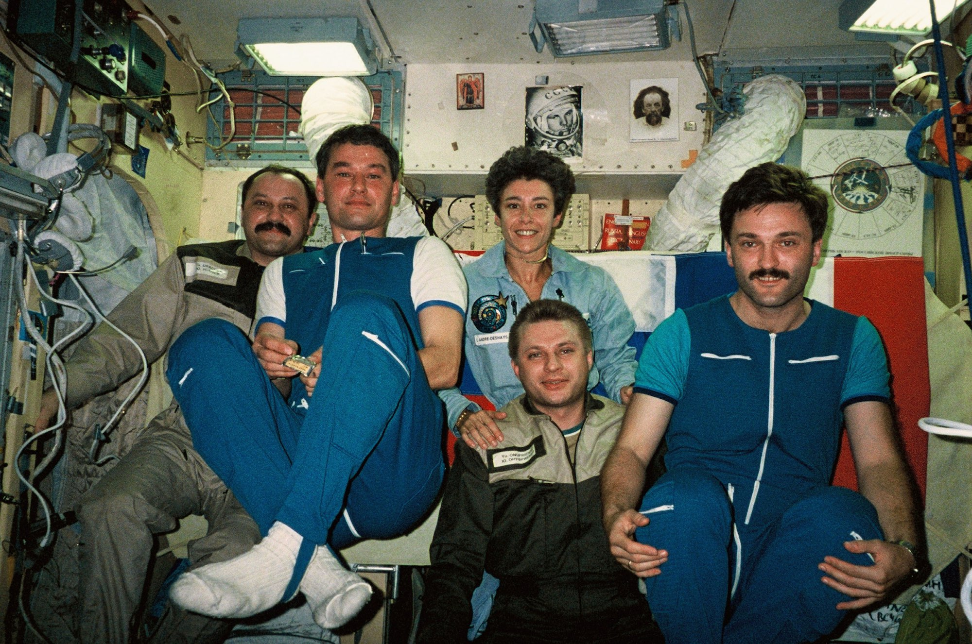 Claudie Haigneré aboard Mir during her Cassiopeia mission in 1996.  Here in the centre, she is with (left to right) Yuri Usatchev, Valeri Korzun, Yuri Onufrienko and Alexander Kaleri. Credit CNES/Claudie André-Deshays